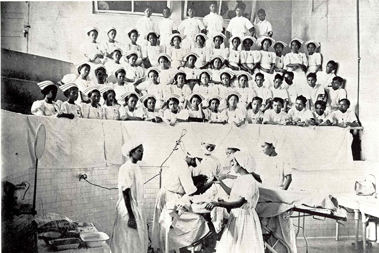 A senior class receives instruction in operating room techniques at the Philippine General Hospital (c. the 1900s).4